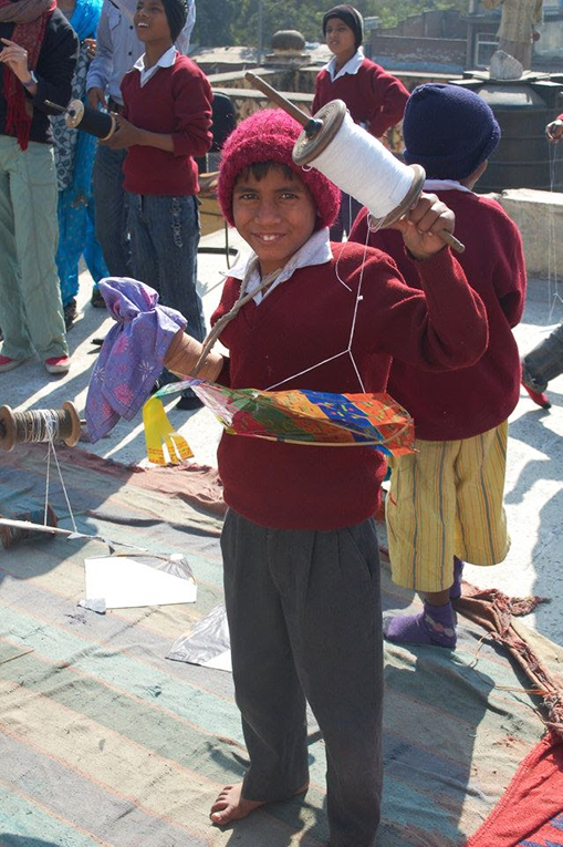 Indian student holding a kite