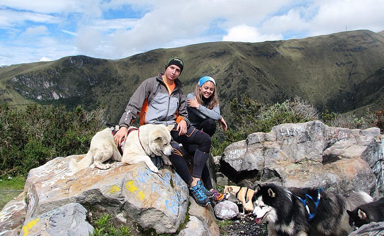 Couple and their dog hiking Pichincha in Quito, Ecuador
