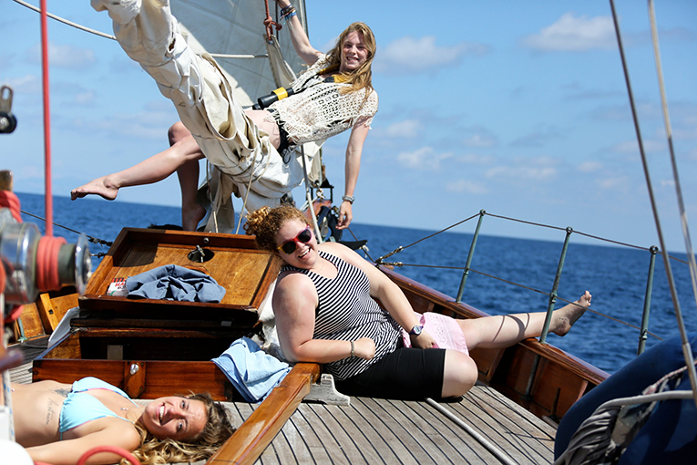 Girls lounging on a sailboat