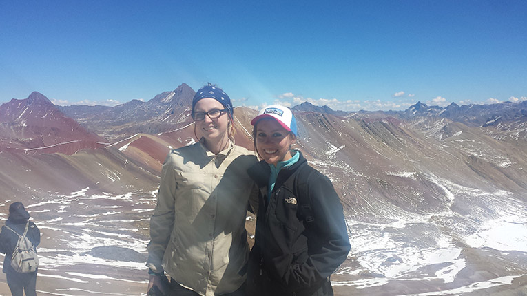 Girls at the top of Rainbow Mountain in Peru