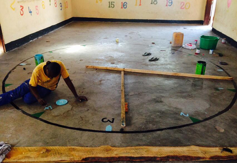Volunteer painting a nursery school in Malawi