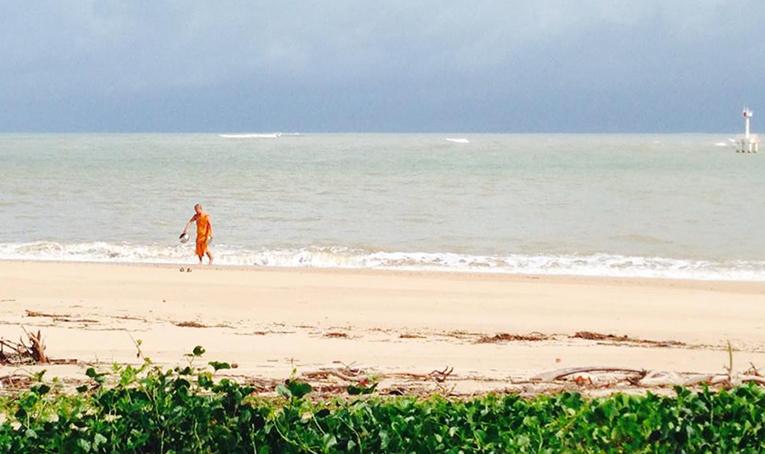Monk on a beach in Thailand