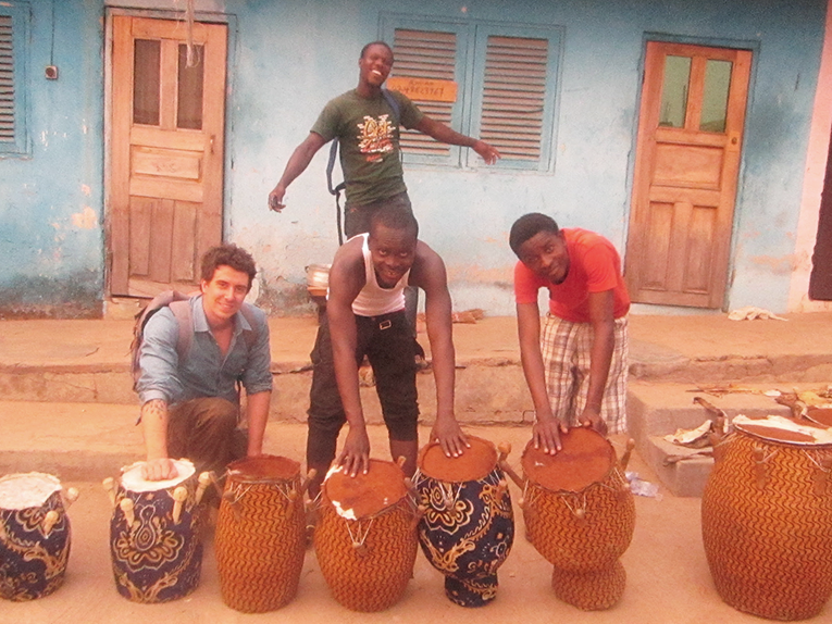 Volunteer and locals with drums in Ghana