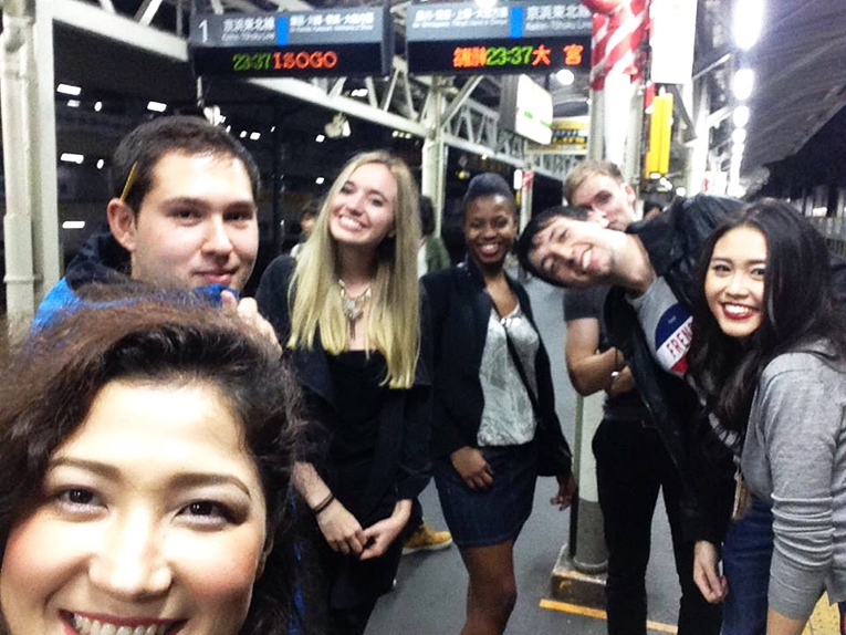 Foreigners waiting for a train in Tokyo, Japan