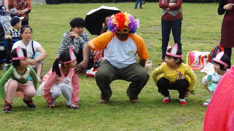 Kids playing a game in a park in China