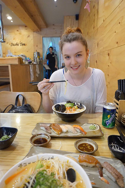 A woman eating udon in Seoul, South Korea