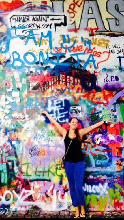 In front of the John Lennon Wall in Prague, Czech Republic