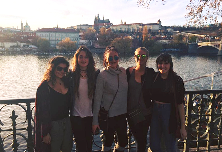 Girls posing near the banks of the Vitava River in Prague
