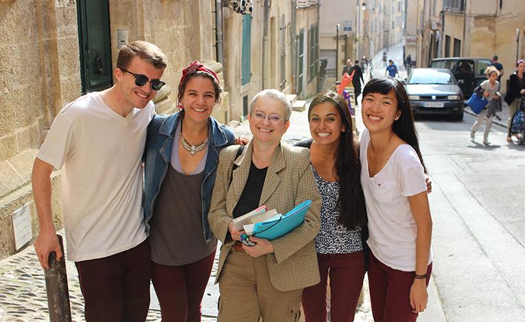 IAU Assistant Dean with honors students outside Centre dEtudes Francaises