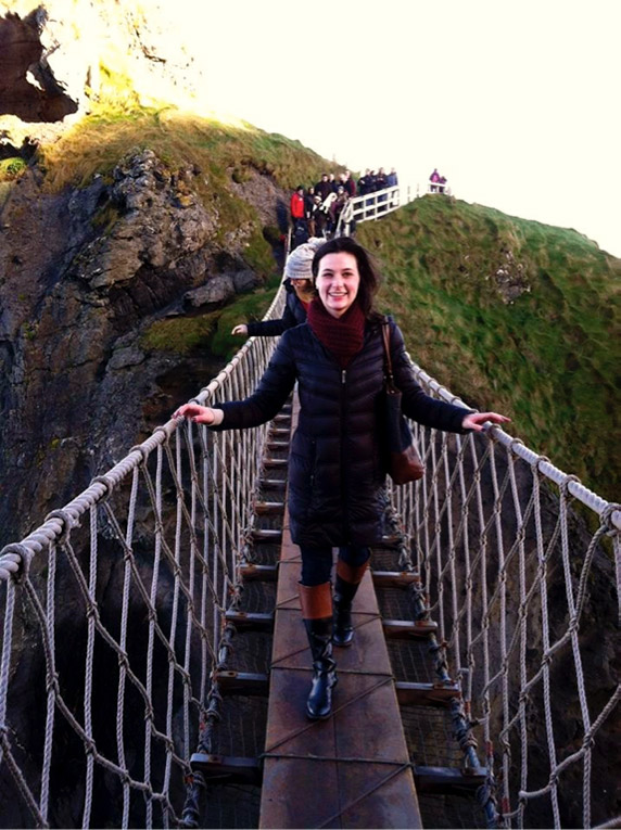 Study abroad student on the Carrick A Rece rope bridge