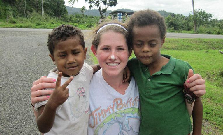 Volunteer with local children in Rukua