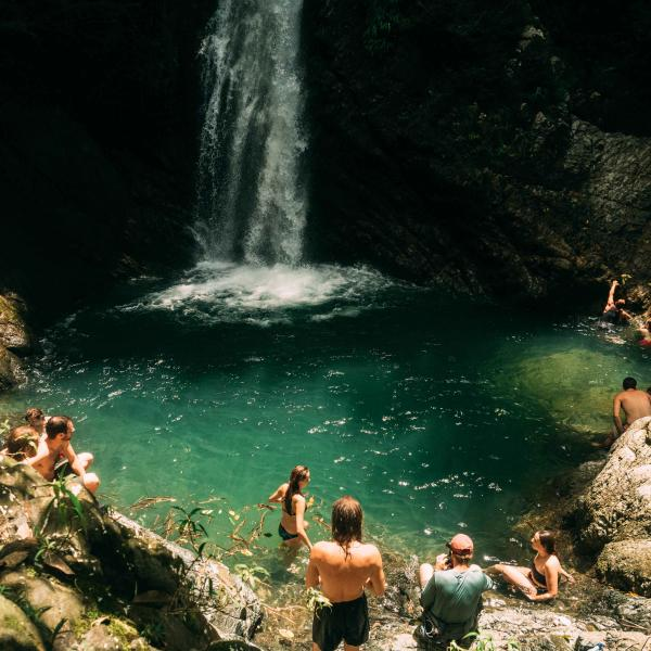 Students enjoy a hike to a nearby waterfall
