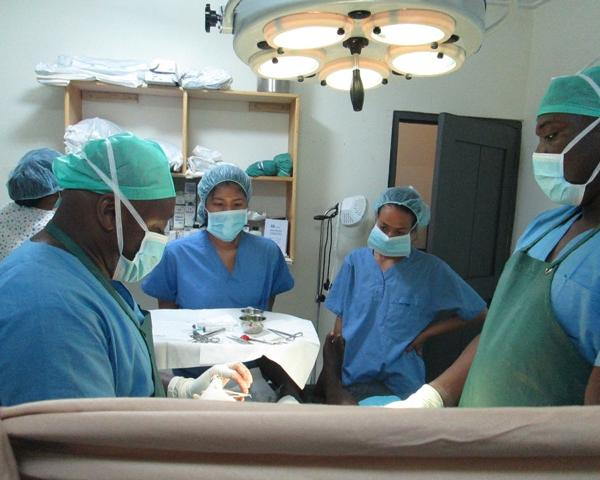 Hospital Volunteer observing whiles our Directors performs surgery