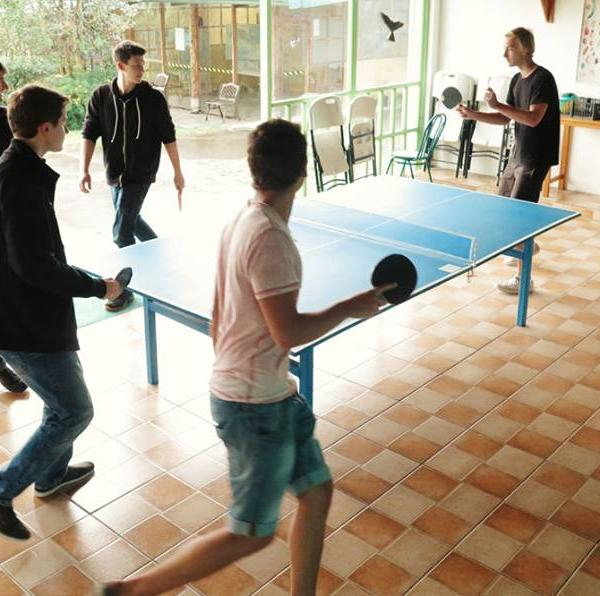 Enjoying the free time playing table tennis