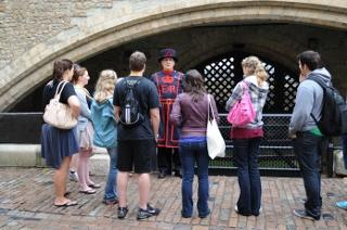 Students looking at a British guard