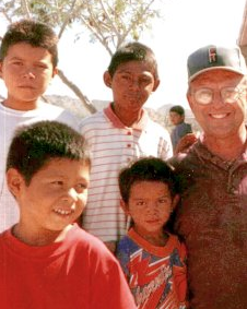 volunteer surrounded by smiling children of Guatemala