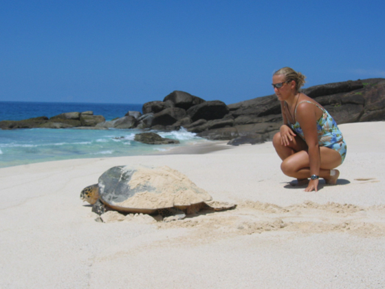 A woman and a turtle