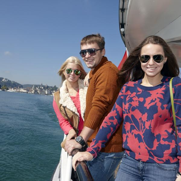 Students participate in various recreational activities like boating on Lake Lucerne