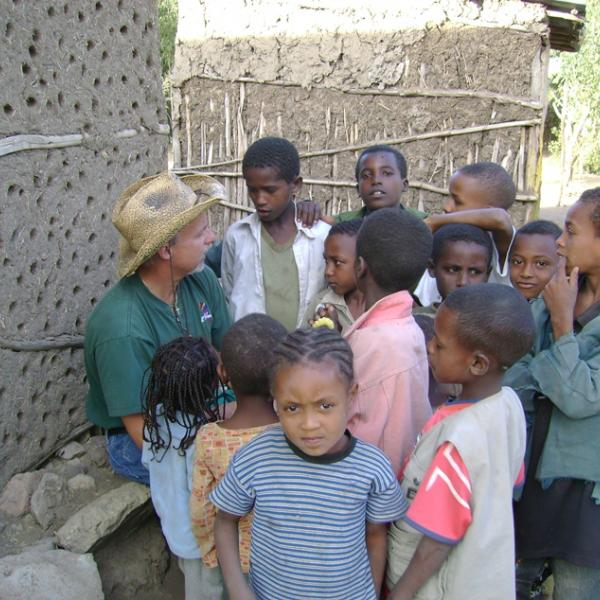 Children in Ethiopia, Africa gathered around a missionary