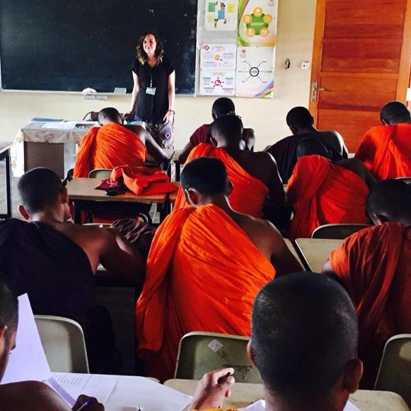 A olunteer in Sri Lanka teaching English as part of the mental health placement