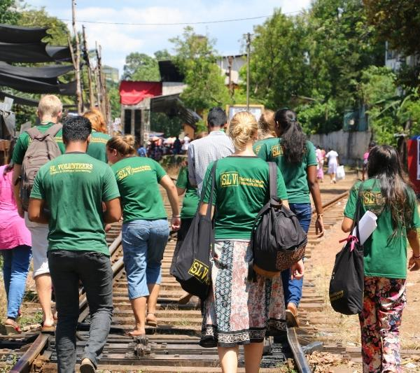 Volunteer in Sri Lanka, walking home from projects with national coordinators