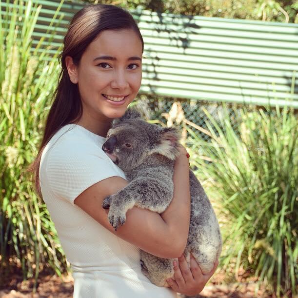 Girl carrying a koala