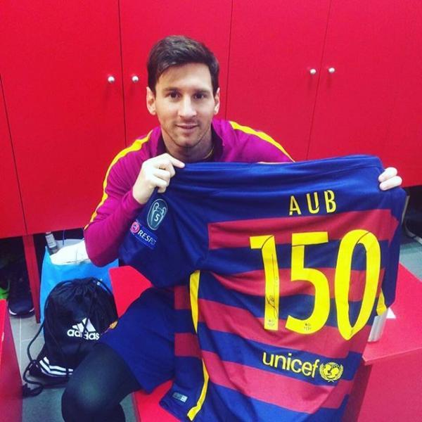 Lionel Messi celebrates AUB