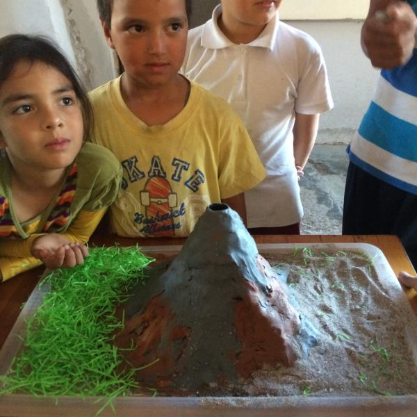 Volunteerin with children providing recreational activities in Mexico at Club Jerry.