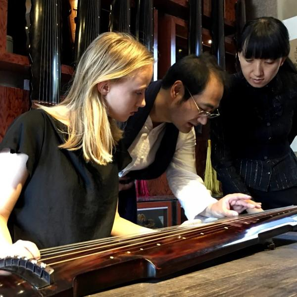 Traditional Event: Chinese Guqing teacher is teaching Au Pair Laura.