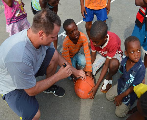 A sports coach teaching basketball on a Sports Coaching Volunteering Abroad project in Jamaica