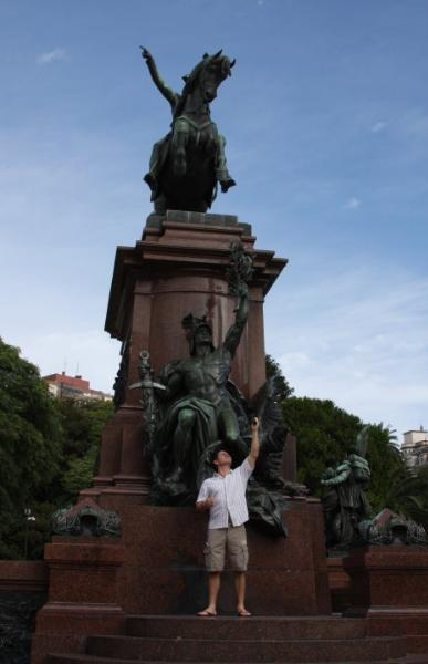 Student posing in front of famous monument