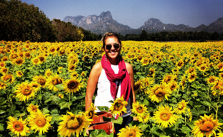 A woman in a sunflower field in Thailand