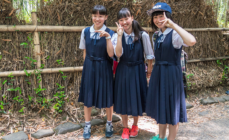 Three young Japanese girls in school uniforms