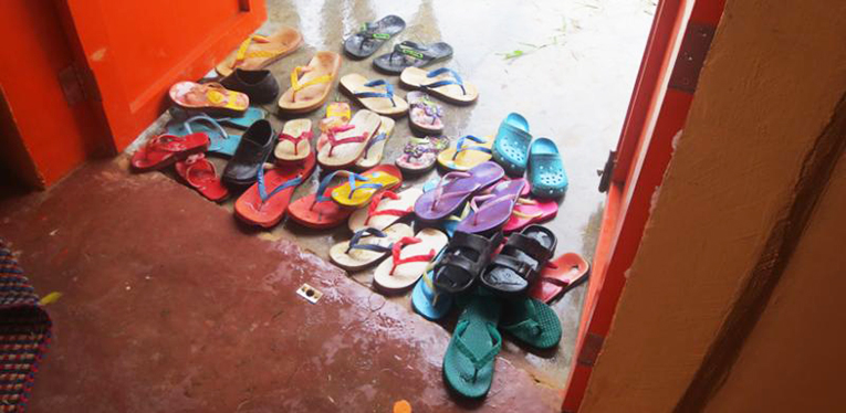 Slippers and shoes left outside the door