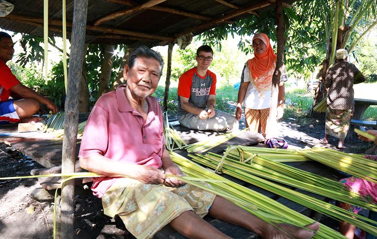 Thai natives weaving coconut leaves