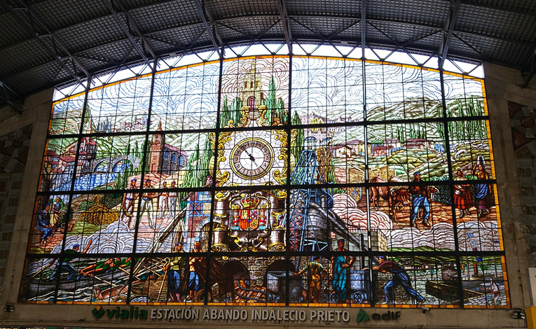 large stained glass window and facade at Bilbao station