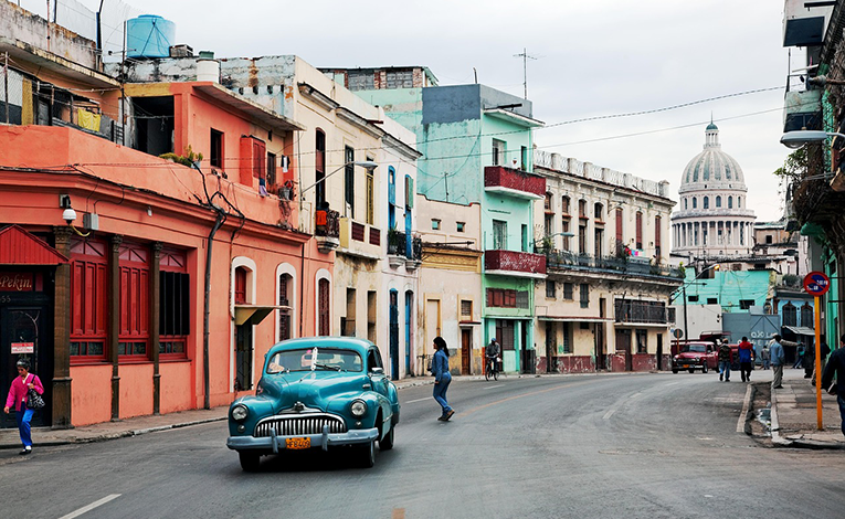 Bright buildings and vintage cars in Havana, Cuba