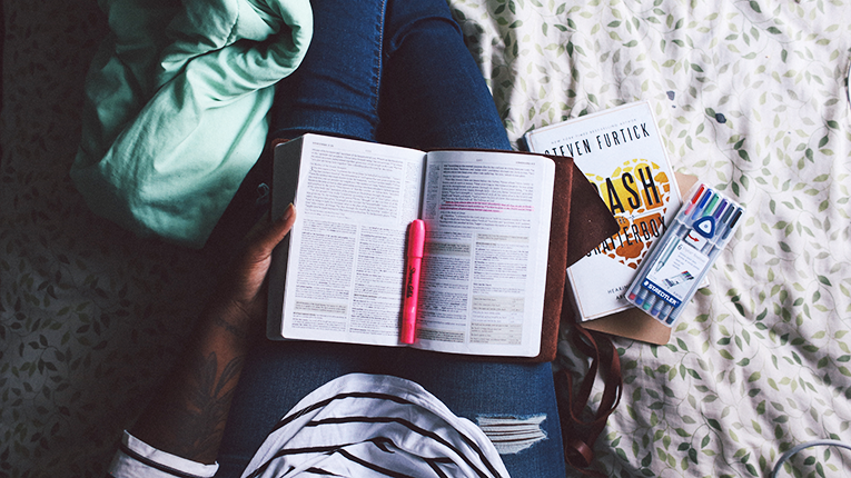 Girl highlighting her textbook