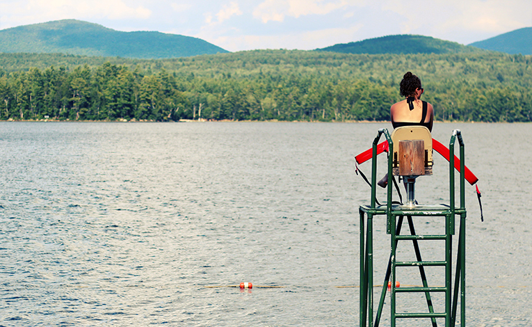 Lifeguard looking out over a lake
