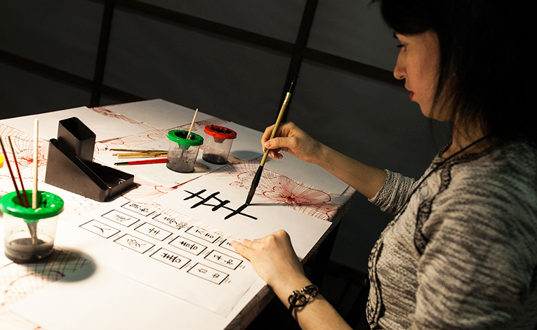 A woman learning calligraphy in Japan