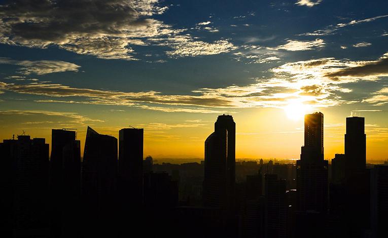 Sunset over Singapore city skyline
