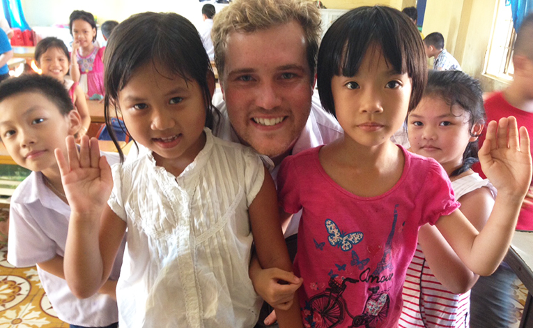 Volunteer teacher with students in Vietnam