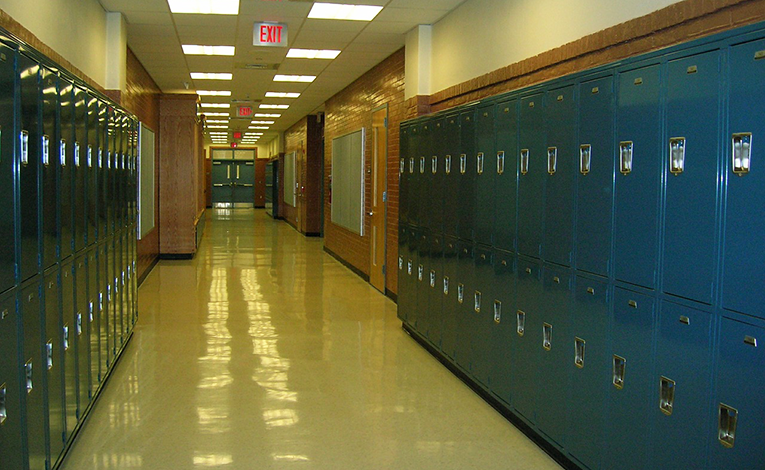 Hallway filled with blue lockers at a high school