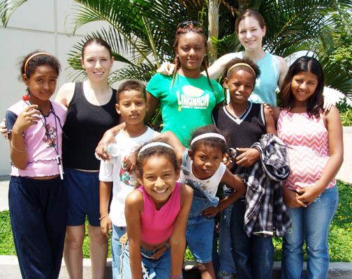 International teacher with children in South America