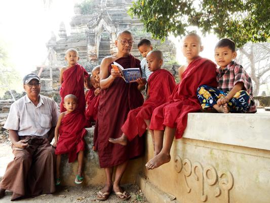 Burmese monks reading in Myanmar