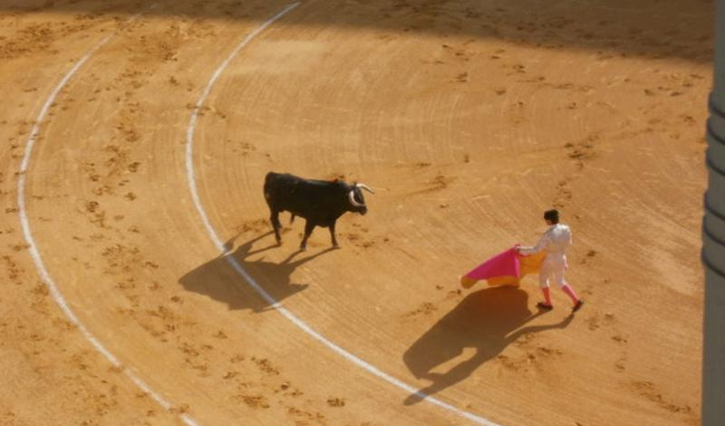 A matador and bull in the ring in Spain