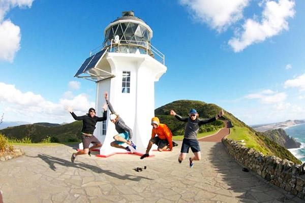 Mark and his friends at Cape Reinga  the tip of the North Island and the start of the 2-month cycling tour