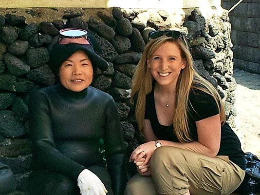 Jessica with Jeju Island's famous haenyo (female diver) representing a matriarchal structure who have dominated the society since the 17th century.