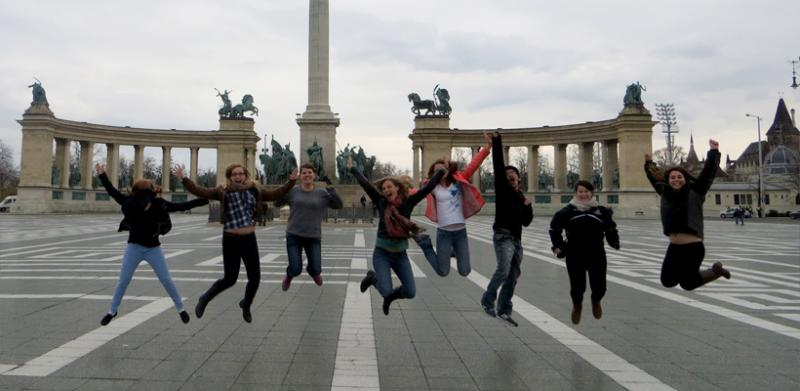 Study abroad students jumping for a photo in Europe