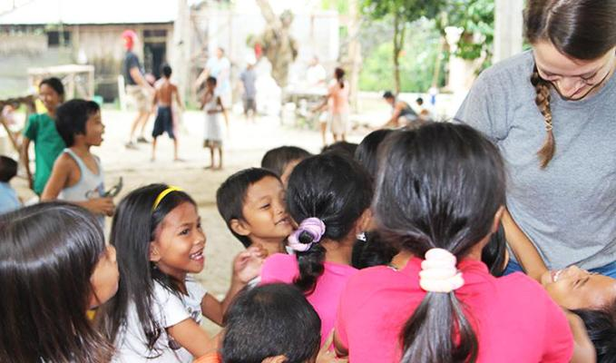 Elsa sharing smiles with children in the Philippines
